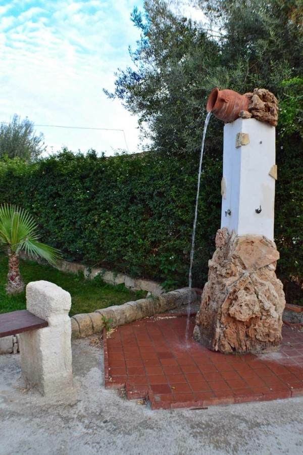 ducha jardín rústica jarra barro