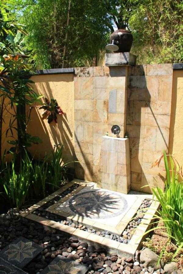 ducha muro piedras jardín
