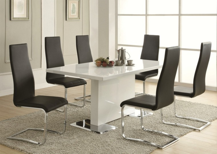 estilo-contemporaneo-mesa-comedor-blanca-sillas-negras-cuero