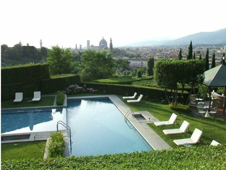 estilo tumbonas piscina moderna enterrada