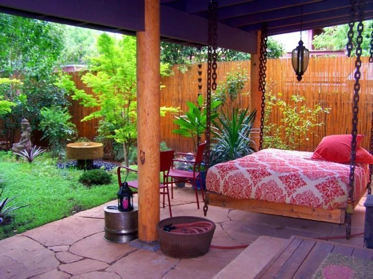 estupenda cama colgante porche casa