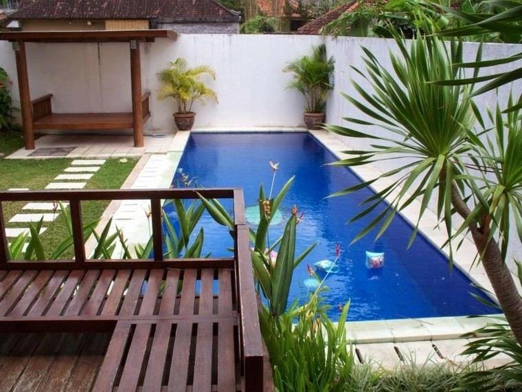 Una piscina peque a en el patio trasero un gran capricho for Dec para terrazas
