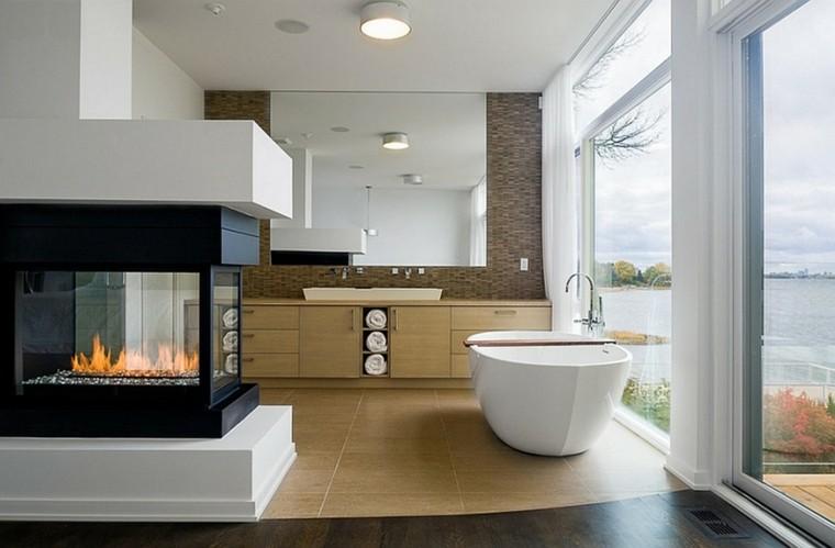 estupendo baño chimenea cristal vistas