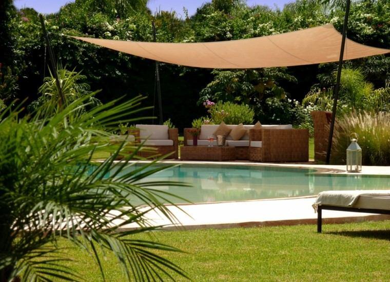 exterior carpa piscina flores palmera