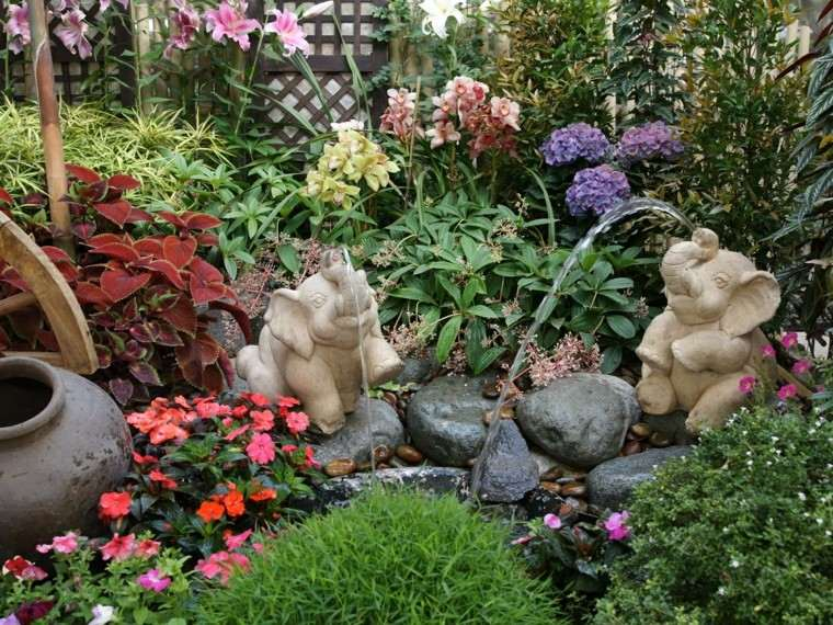 fuente elefantes jardin pequeno flores tropical