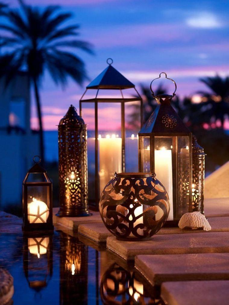iluminacion jardines madera velas palmeras