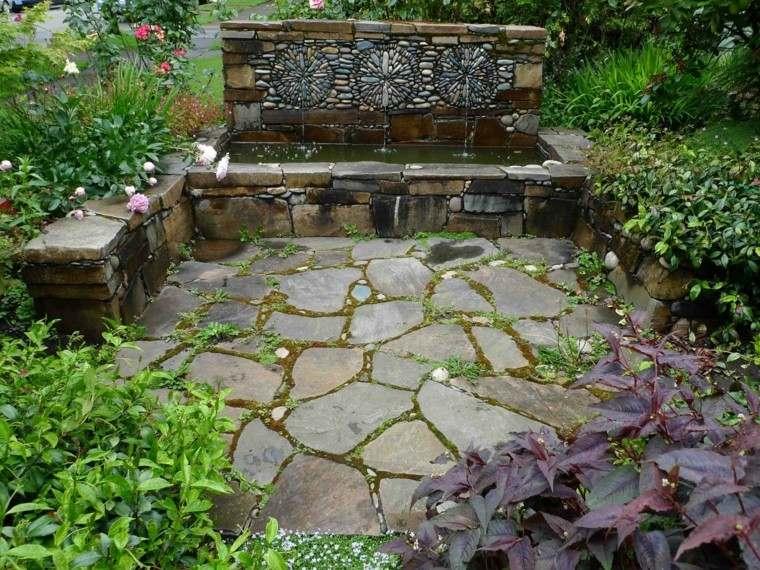 jardin ideas fuente piedra rodeado plantas moderna