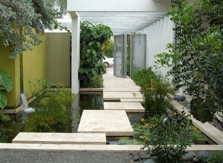 jardin y decoracion puente flores grava estanque