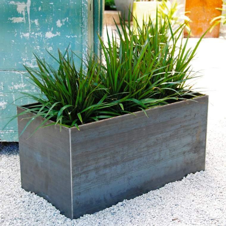 jardineras rocas acero plantas grava