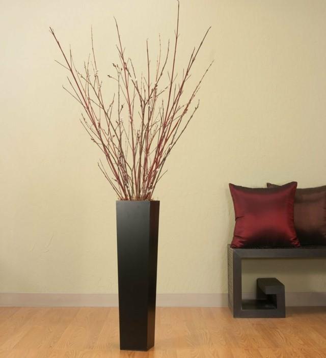 jarron negro alto ramas arbol moderno salon