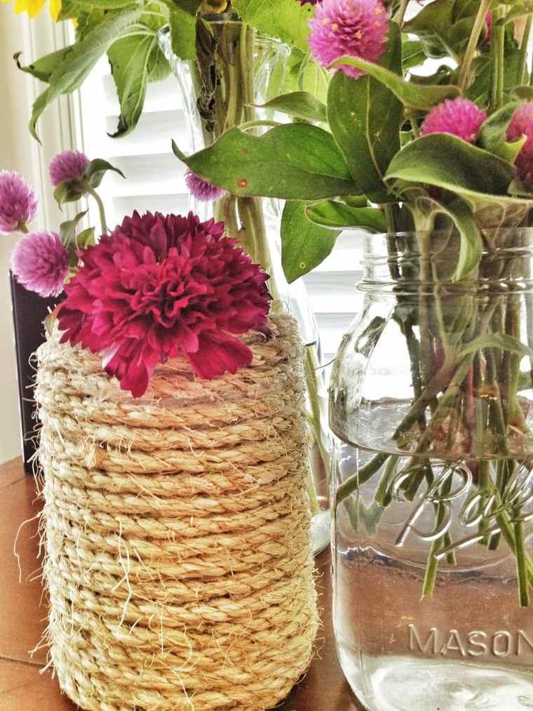 jarrones flores color rosa cuerda