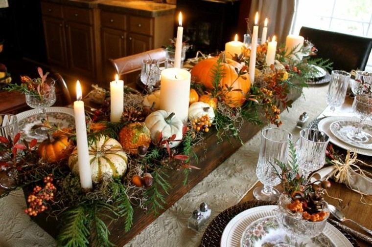 mesa con decoración calabazas velas calabazas