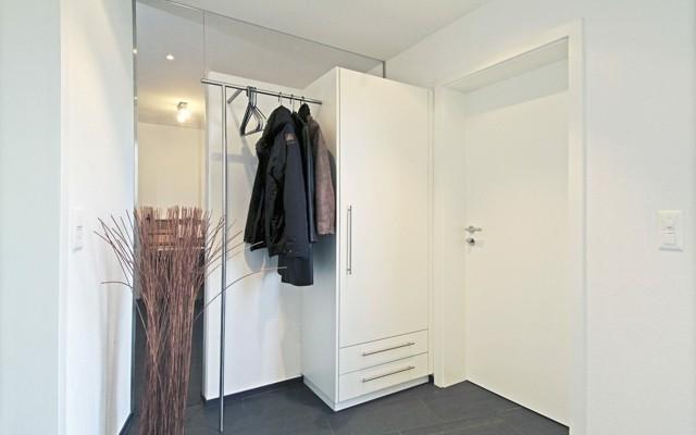 Muebles de entrada ideas que invitan a remodelar - Armarios empotrados para entradas ...