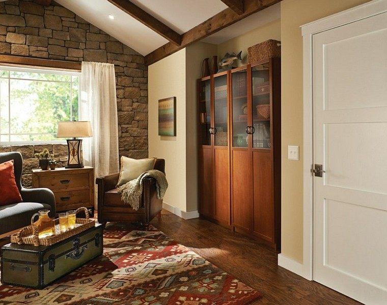 muebles rústicos sillon cuero pared piedra alfombra