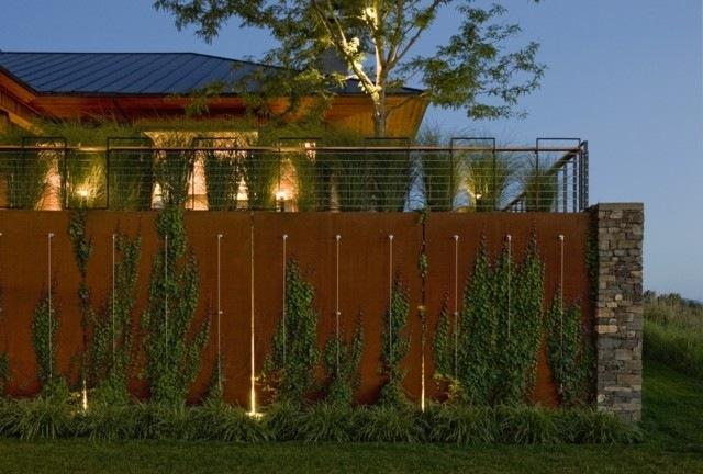 muro exterior luces cesped terraza