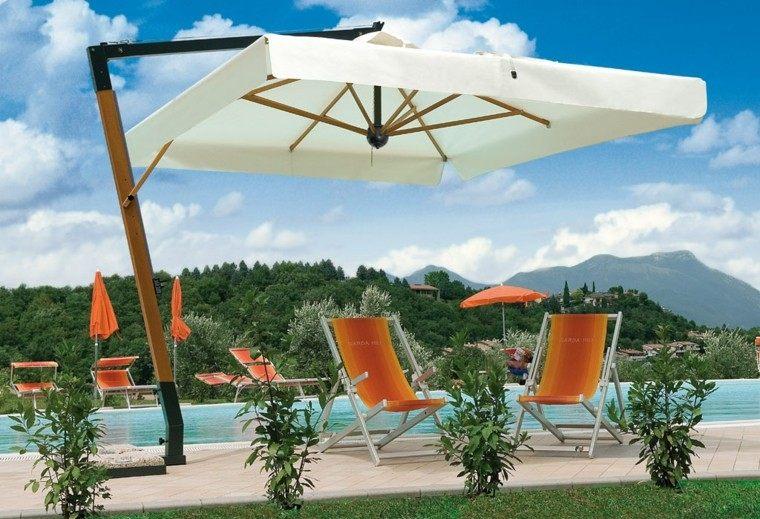 parasoles jardin sillas naranjas