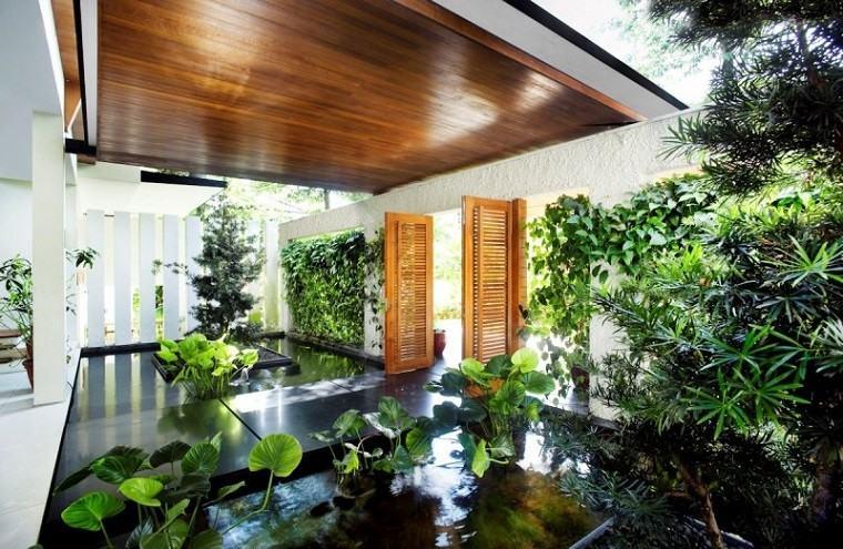 patio cubierto techo madera jardin