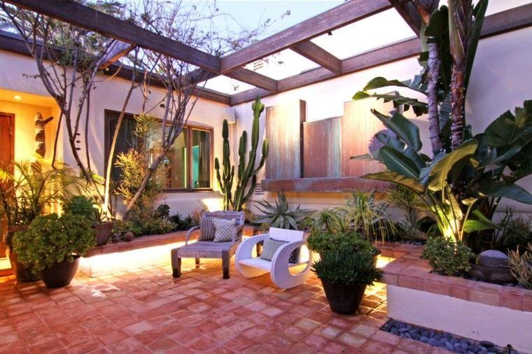 pérgola jardín plantas cactus sillas