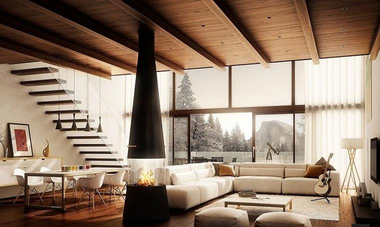salon abierto escaleras chimenea moderna sofa diseño grande