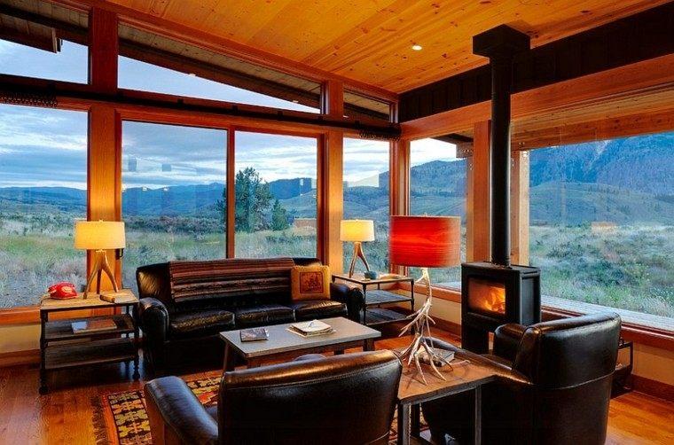 salon moderno ventanales luminoso muebles cuero negro chimenea