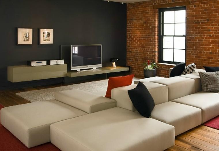 salon pared ladrillos sofa beige