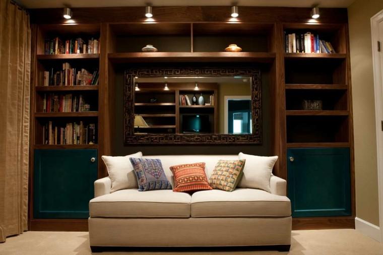 sofa cojines lamparas libros luces