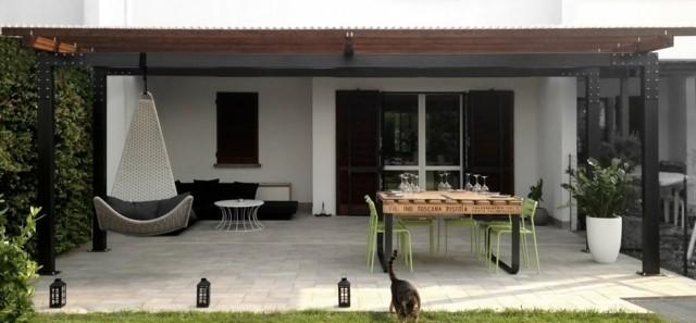 terraza pergola silla colgante moderna muebles negros