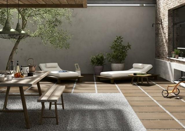 terraza tumbonas banco piedras moderna comodos