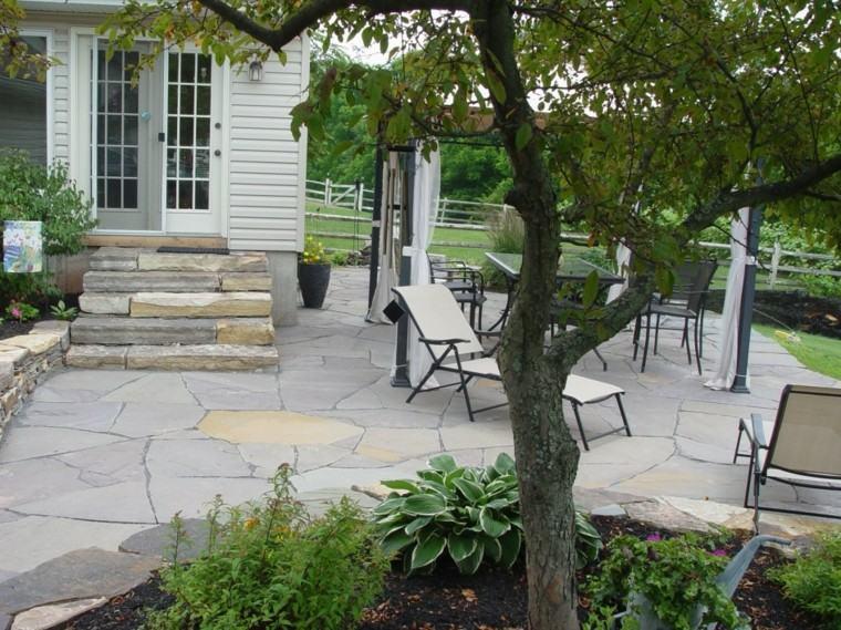 tumbonas jardin patio metalica rocas arboles