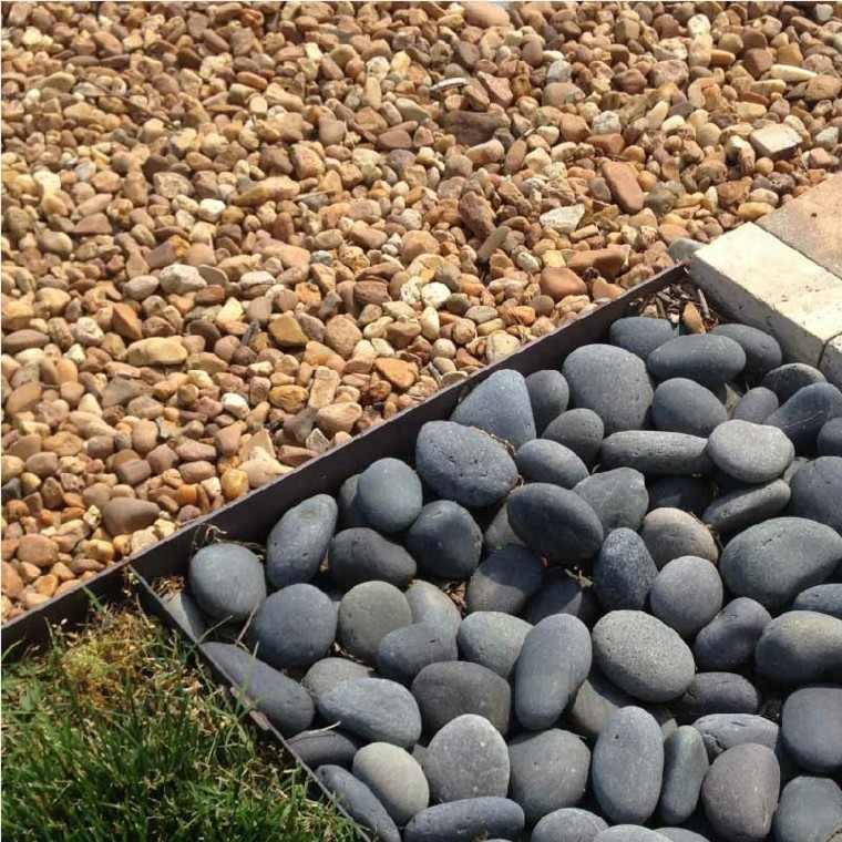 vallas metálicas piedras guijarros zen