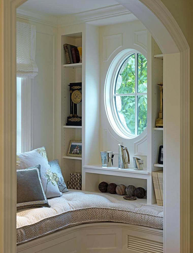ventana lectura reloj esferas libros