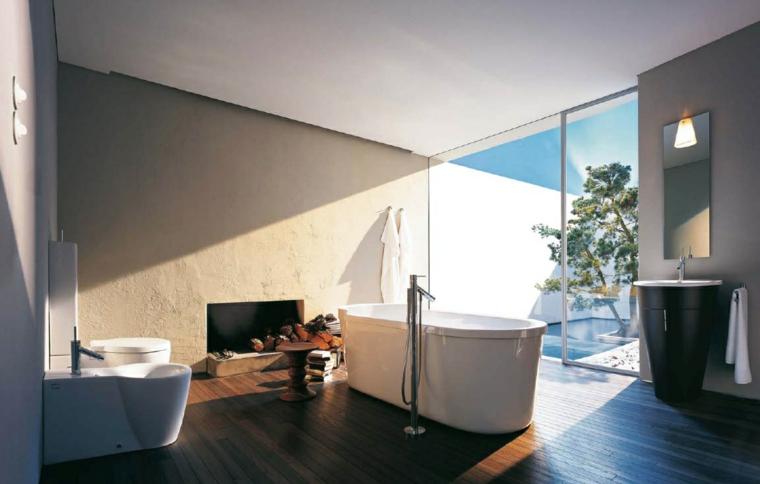 baño chimenea vistas jardin bañera