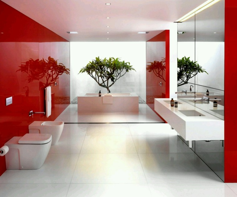 Baño Minimalista Rojo:Revestimiento del suelo bajo la bañera con piedras de spa