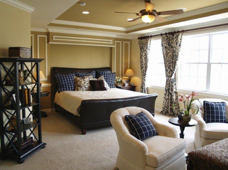 cama cuero cojines azules butacas dormitorio ideas