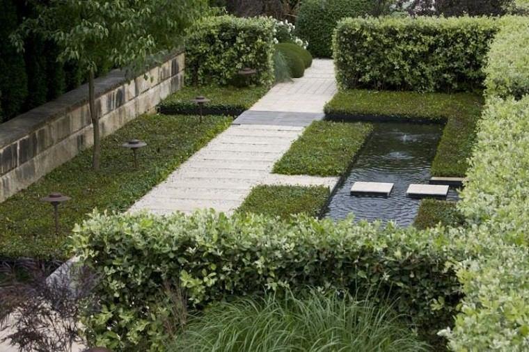 camino jardin baldosas grava estanque