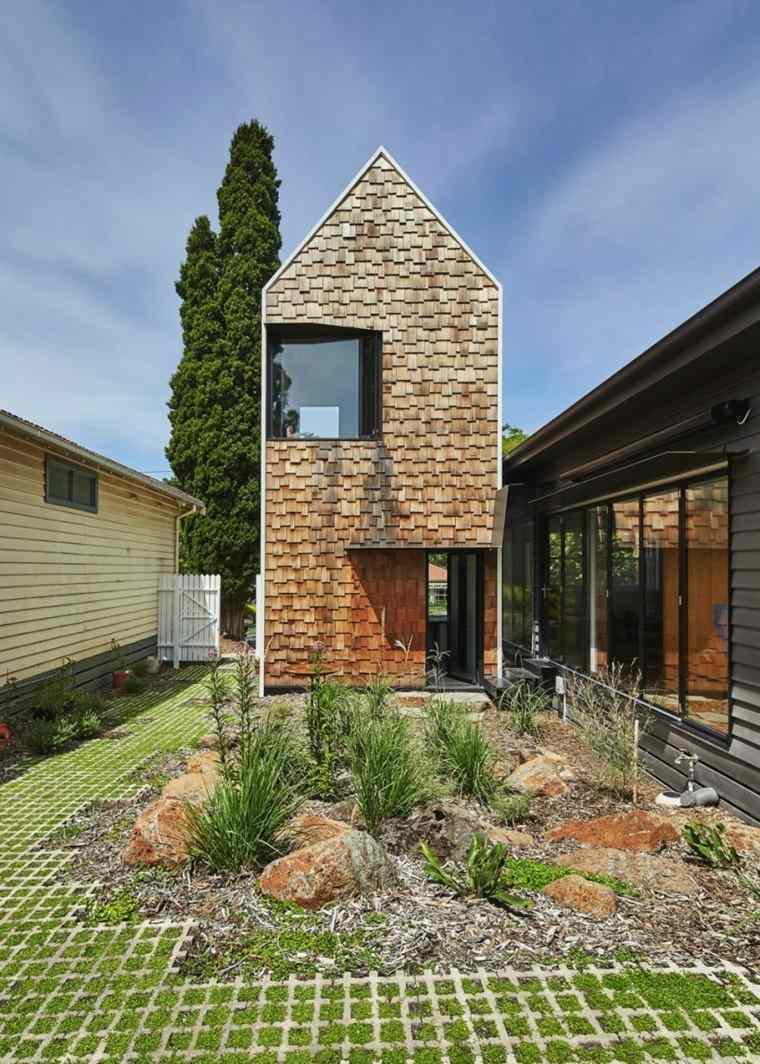 casa torre fachada laminas madera