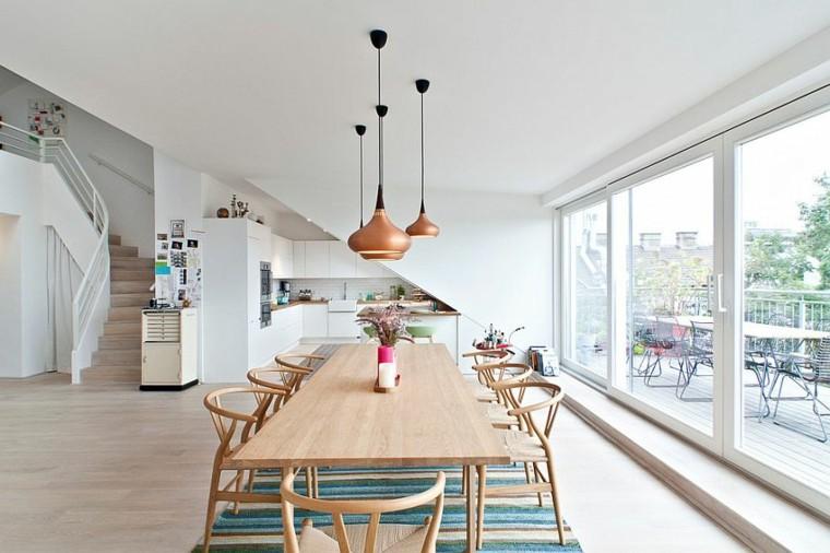 cocina abierta salon amplio ventanal mesa sillas madera lamparas