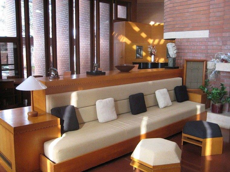 cojines diseño ladrillos pared mueble