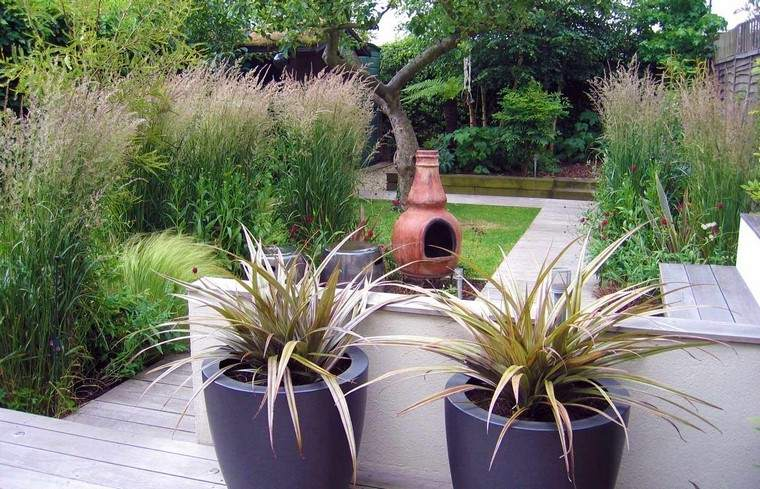 diseño de jardines modernos macetas escultura patio