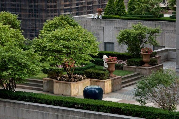 diseño jardin elegante flores jardineras