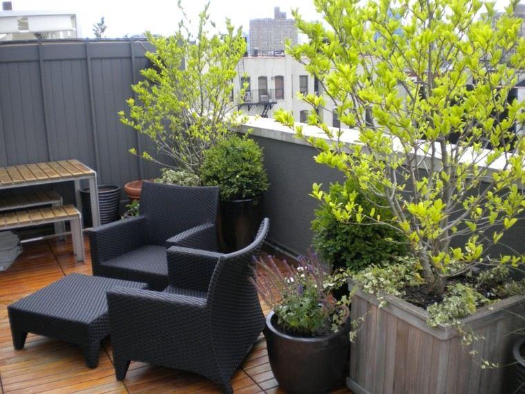 diseño jardin muebles oscuros ratan