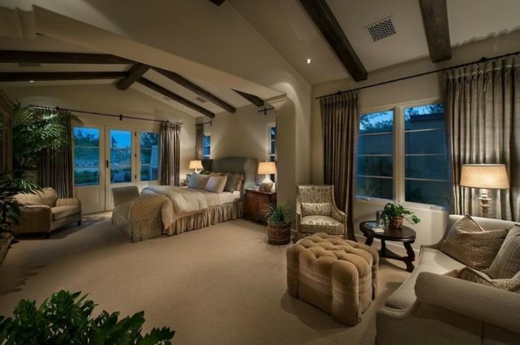 dormitorio amplio sofas butaca mesa cama ideas
