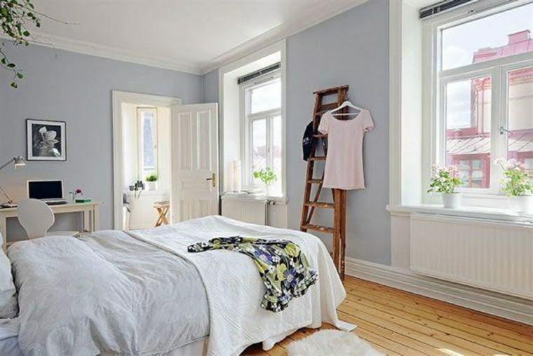 dormitorio diseno escandinavo color azul claro moderno