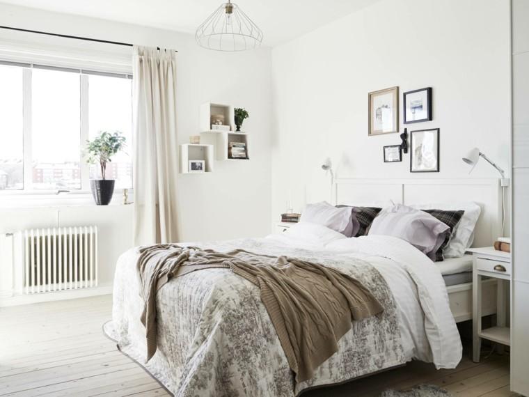 dormitorio diseno escandinavo paredes blancas cuadros moderno