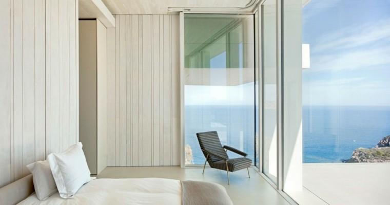 dormitorio ventanales vistas oceano casa Sardinera moderna