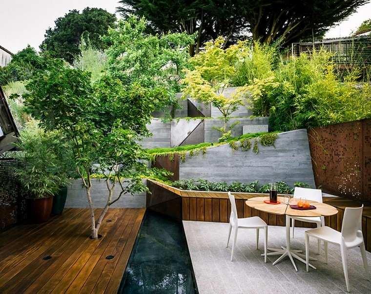 elevacion jardin mesa macetas sillas exterior