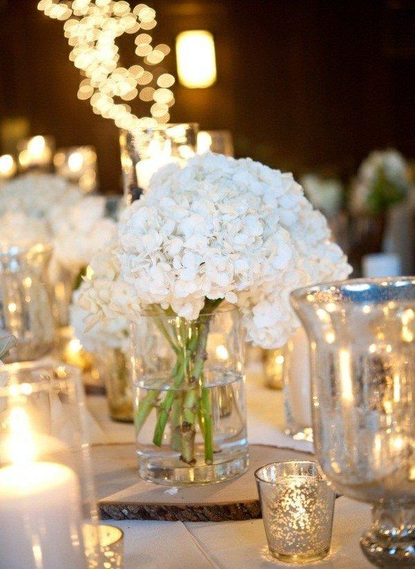 florero cristal flores blancas velas