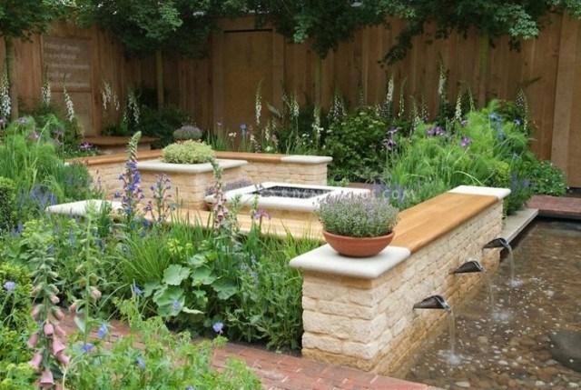 fuente jardin muchas plantas agua