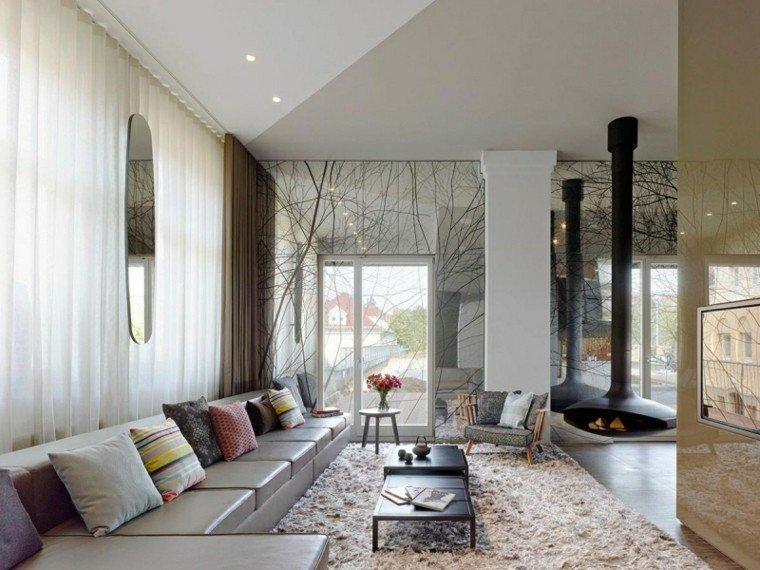ideas decoración espejo grande salon chimenea sofa cuero moderno