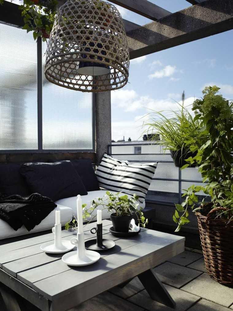 ideas para terrazas mesa lampara velas